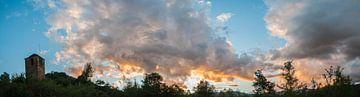 Zon en wolken van