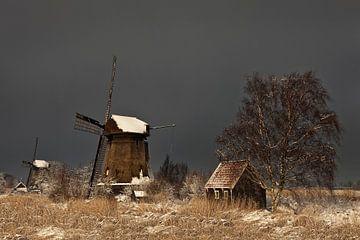 Molen in winterlandschap