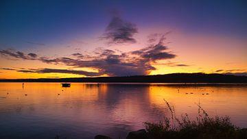 Sonnenuntergang über dem Tollensesee von Thomas Grund