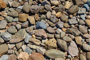 Een zee van stenen in het kleur. van