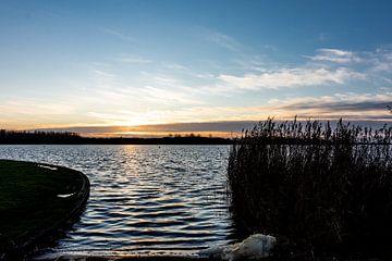 Sunset over water van Meranda Spanjer