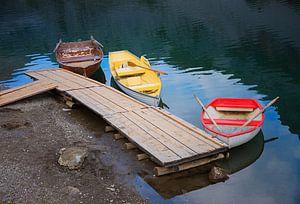 rowing boats at alpine mountain lake