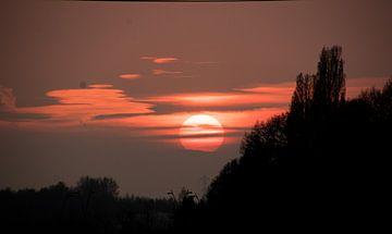ondergaande zon van Maaike Krimpenfort