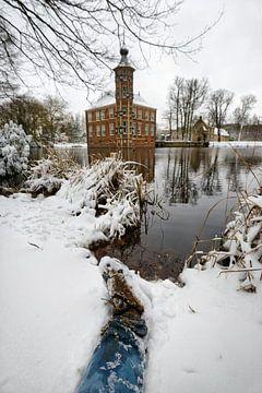 Sneeuwlandschap met kasteel en been