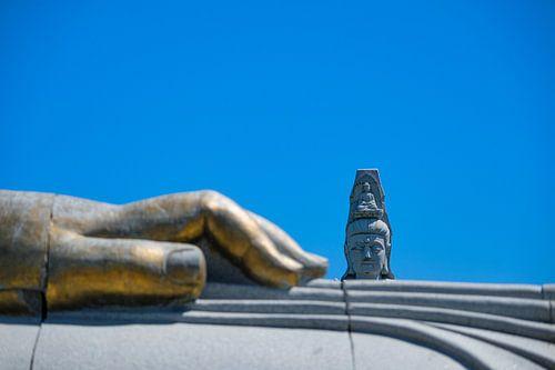 Boeddha achter de hand