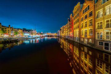 Damrak in Amsterdam van Roy Poots