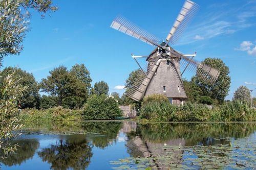 Molen de 1100 Roe met draaiende wieken van Amsterdam Fotografie (Peter Bartelings)