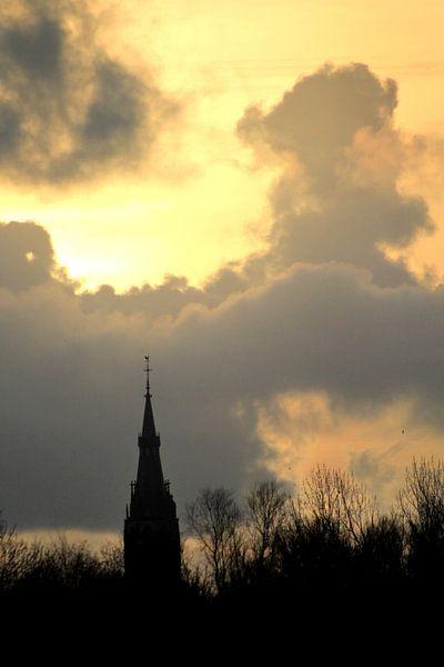 Spire of Delft against a yellow sky van Fleur Halkema
