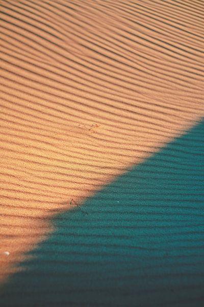 Wind patroon in zand van Andy Troy