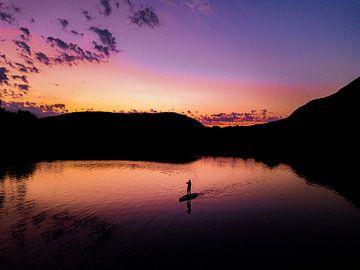 silhouette bij zonsondergang van Martijn de Ruijter