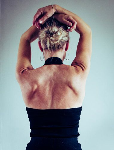 Woman's back,   in color.