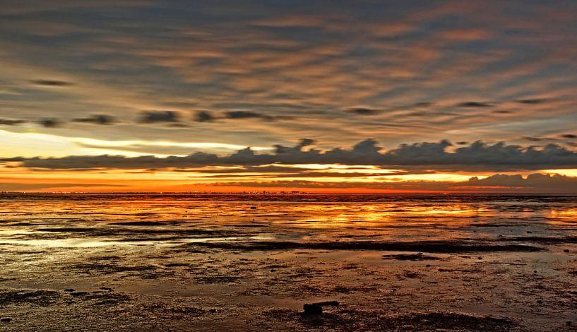 zonsondergang waddenzee van rene schuiling
