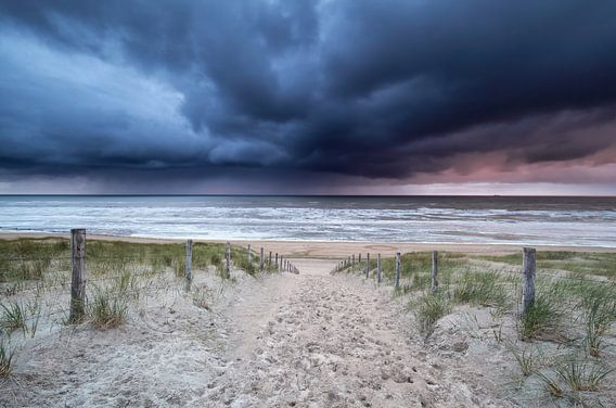 stormy sky and showers over North sea beach