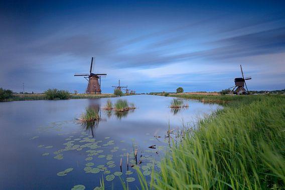 Hollandse wolkenlucht bij de molens van Kinderdijk