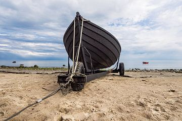 Fishing boat on shore of the Baltic Sea van Rico Ködder