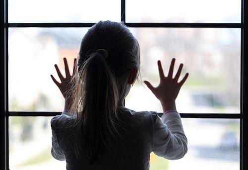 Girl at window van