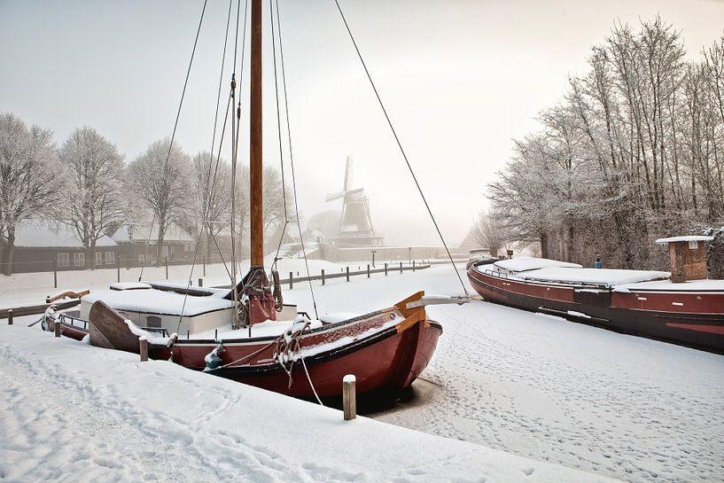 Winters tafereel in Sloten van Frans Lemmens