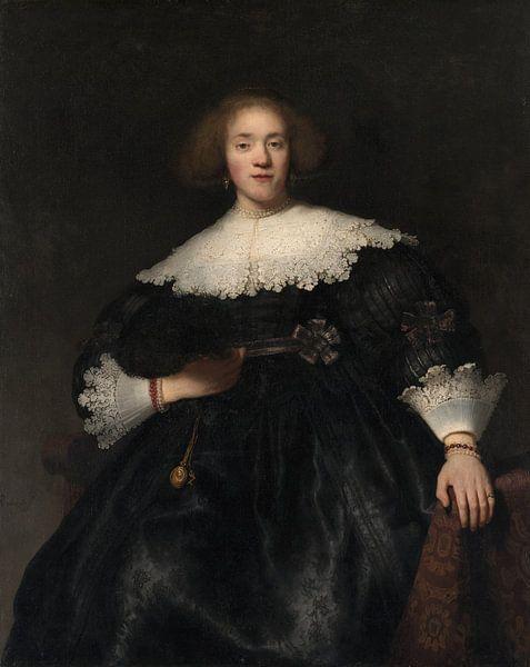 Portret van een jonge vrouw met een waaier, Rembrandt van Rembrandt van Rijn
