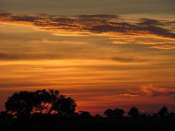 Lucht bij zonsondergang in Afrika von Kim van de Wouw