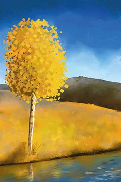 Boom in geel bij een rivier onder een stralend blauwe hemel
