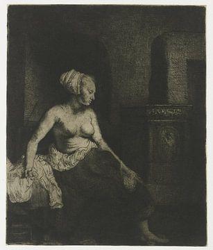 Frau mit nacktem Oberkörper am Herd, Rembrandt van Rijn