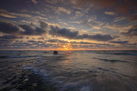 wolkenlucht langs de Noordzee
