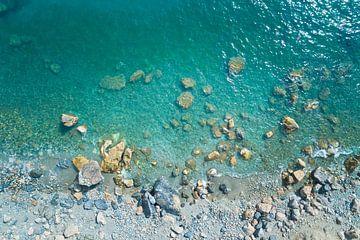Stenen in de zee van