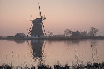 Foggy sunset sur Arjen Roos