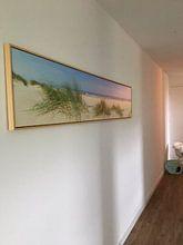 Klantfoto: Panoramisch zicht op het strand in de zomer van Sjoerd van der Wal, op canvas