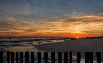 Zonsondergang op het strand van Hans Lubout