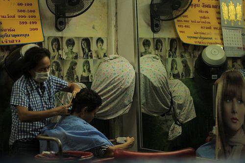 Bij de kapper van
