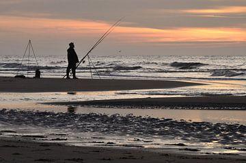 Sportvissen aan het strand van