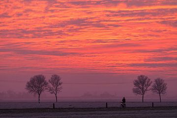 Sunset and a bicyclist sur Menno Schaefer