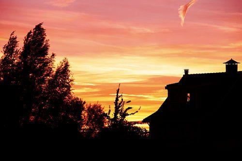 Droomhuis met een dromerige zonsondergang