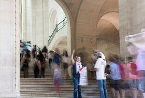 Moving tourists - Louvre Paris