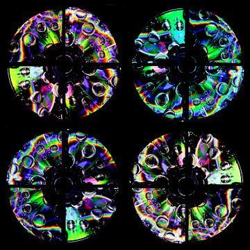 4 CD de musique avec des gouttes d'arc-en-ciel sur