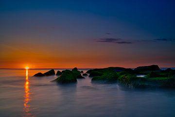 Rotsen uitwatering zonsondergang Katwijk aan Zee van Wim van Beelen