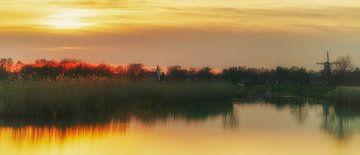Molen en Kerk Roderwolde Drenthe zonsondergang  van R Smallenbroek