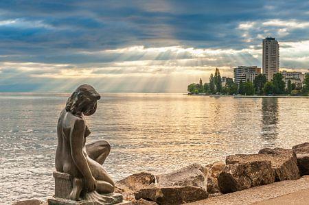 Small statue of a bather on Lake Leman (Switzerland).