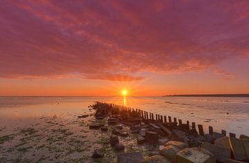 Breakwater of Wadden Sea harbor at Sunrise sur