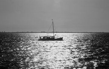 Bootje aan de horizon van