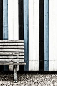 Abstract lines in a bench and wooden wall