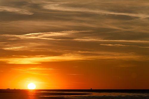 zonsondergang op het werelderfgoed het wad  van