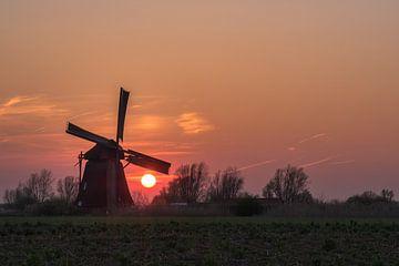 Oranje zon bij molen von Moetwil en van Dijk - Fotografie