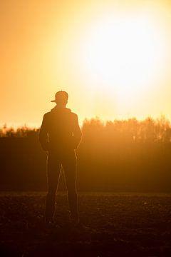 Silhouette bei Sonnenuntergang von Martijn Aleman