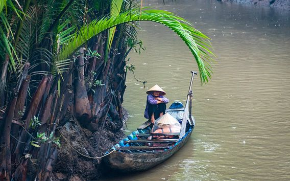 Schuilen voor de regen, Mekong delta, Vietnam