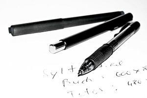 Writing instruments, words, paper