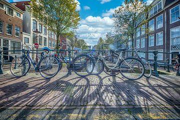Shadows in Amsterdam van Foto Amsterdam / Peter Bartelings