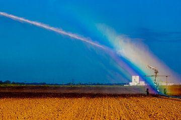 Regenbogen bei der Bewässerung des Landes von Niels Wenstedt