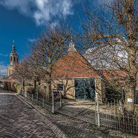 Straatje en schuur in Dronrijp, Friesland van Harrie Muis